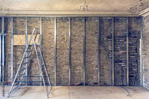 Working process of installing metal frames for plasterboard (drywall ...