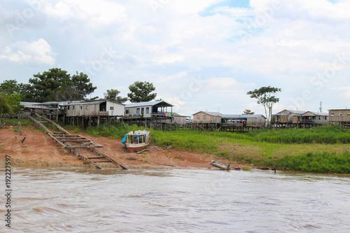 Fotografia, Obraz  Amazon river houses on stilts in Amazonas, Brazil