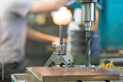 Photo  metalworking industry: boring on pillar drill machine with high speed steel dril