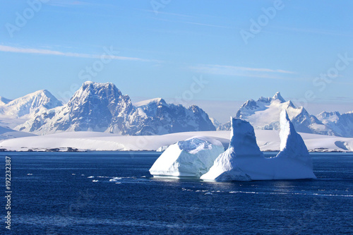Antarctica on a Sunny day- Antarctic Peninsula - Huge Icebergs and blue sky.