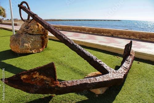 Spoed Foto op Canvas Mediterraans Europa Old anchor on a promenade of Santa Pola, Alicante