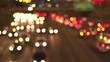 BOKEH: Colorful blurry car lights on busy jammed multiple lane highway at night