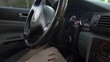 Woman driver hand inserting car key and starting engine. Transportation. Closeup