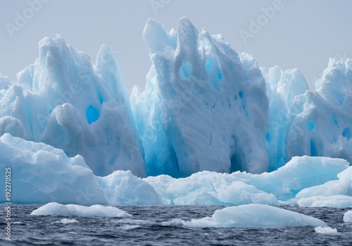 Foto op Aluminium Antarctica Blue iceberg floating in Esperanza in Antarctica with fissures, crevices and cavities.