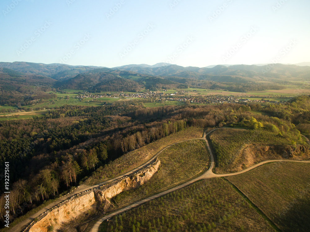 Fototapeta arial view of majestic landscape with roads, forest and hills behind, Germany