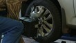 Car wheel fixed with computerized wheel alignment machine