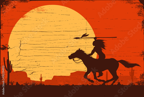 Cuadros en Lienzo Silhouette of Native American Indian riding horseback with a spear on a wooden s