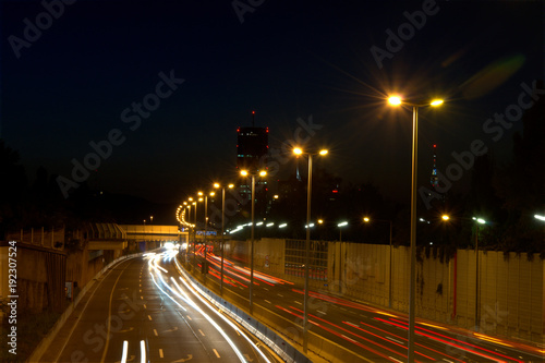 Tuinposter Nacht snelweg Night shot of car highway / night shot of car highway Vienna, skyscrappers at the background