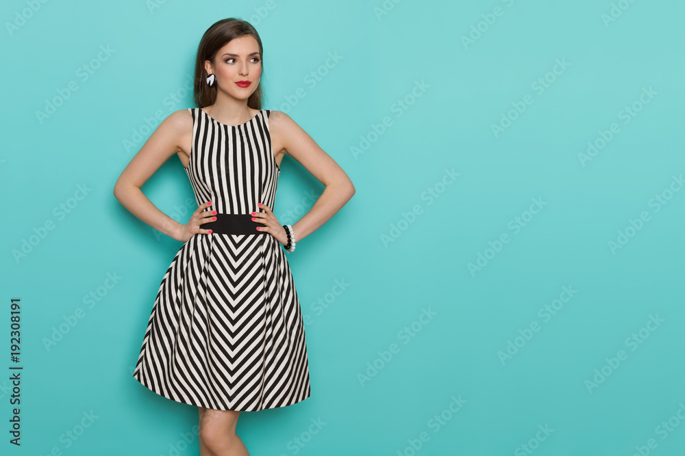 Fototapety, obrazy: Beautiful Young Woman In Black And White Striped Dress Is Looking Away