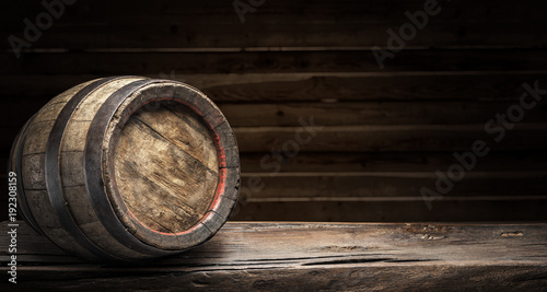 Cuadros en Lienzo Wine barrel on the old wooden table.