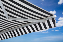 Black And White Striped Awning...