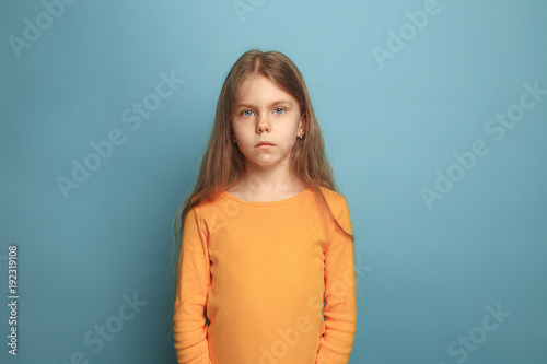 The serious teen girl on a blue background Fototapet