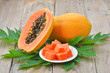 canvas print picture - papaya on wooden background