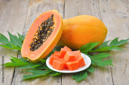 papaya on wooden background