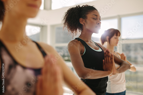 Door stickers Yoga school Woman practice yoga with friends in gym