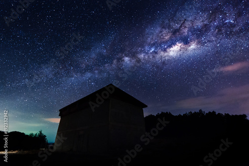 Wall Murals UFO starry night sky with milky way galaxy. image contain soft focus, blur and noise due to long expose and high iso.