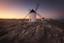 Don Quixote Windmills At Sunset. Famous Landmark In Consuegra, Toledo Spain.