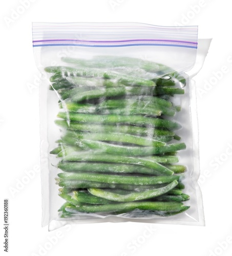 Plastic bag filled with green beans on white background