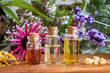 Bottles of essential oil with calendula, frankincense, echinacea, lavender