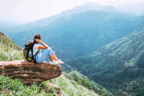 Cuadros en Lienzo Tourist woman enjoy with beautiful view on mountains and valley in Ella, Sri Lan