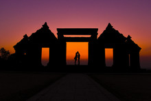 Silhouette Couple Kissing On Gateway Of Ratu Boko Ruins Against Clear Sky