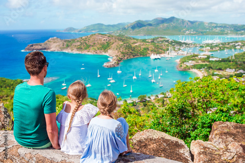 Family enjoying the view of picturesque English Harbour at Antigua in caribbean Wallpaper Mural
