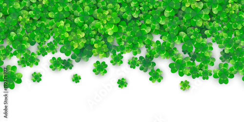 Fotografia Patricks Day seamless background with four green clover heap with shadows