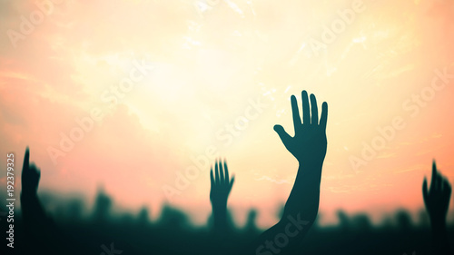 Fototapeta  International migrants day concept: Silhouette many people raised hands over aut