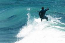 Surfer In California Surfs Lar...