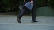 Man walking with duffle bag and lunch box close up