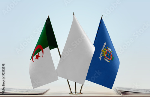 Flags of Algeria and Melilla with a white flag in the middle