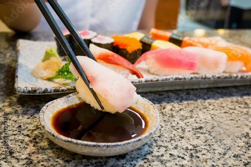 Poster Sushi bar close up sushi sashimi set with chopsticks and soy sauce