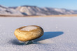 A small pebble on the ice of Lake Baikal