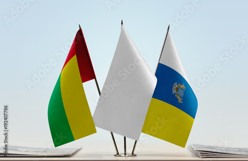 Fotografia  Flags of Guinea-Bissau and Canary Island with a white flag in the middle