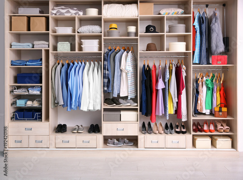 Fotografie, Obraz  Big wardrobe with different clothes for dressing room