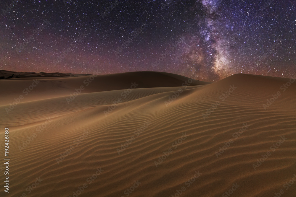 Amazing views of the Sahara desert under the night starry sky.