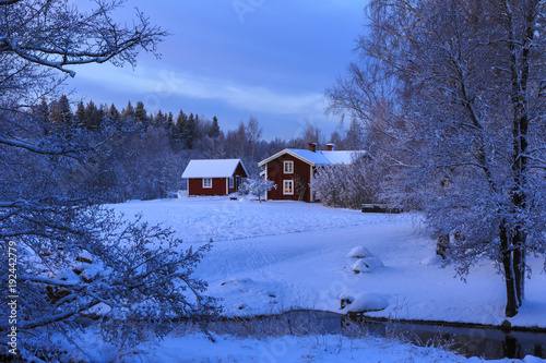 House By Bare Trees During Winter In Stocka Sweden