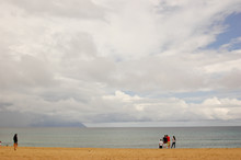 Beach On Cloudy Day,  With Few...