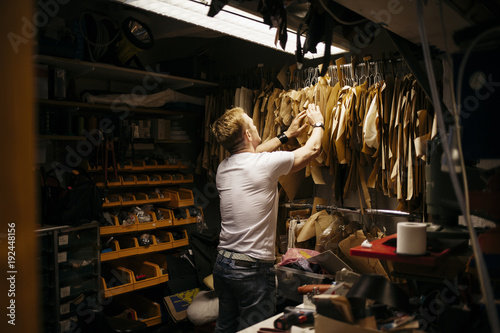 Man in leather workshop