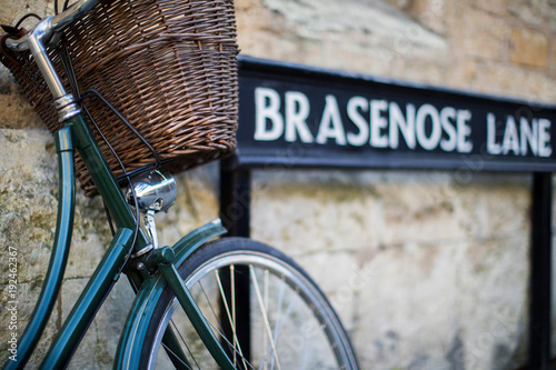 Photo Bicycle Next To Brasenose Lane Sign Outside Oxford University College Buildings