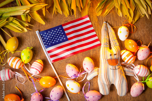 Feast of Easter in the USA. Two rabbits with Easter eggs
