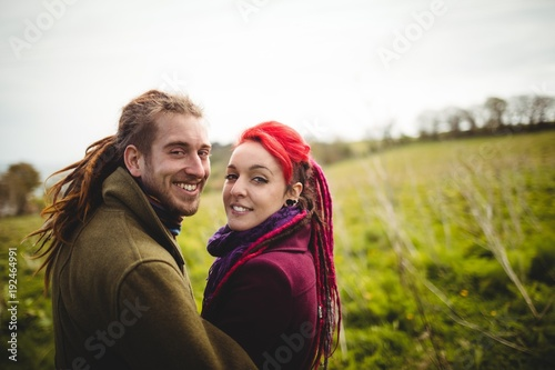 Portrait of smiling hipster couple at park