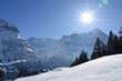 Sun shines above Eiger in Grindelwald, Switzerland