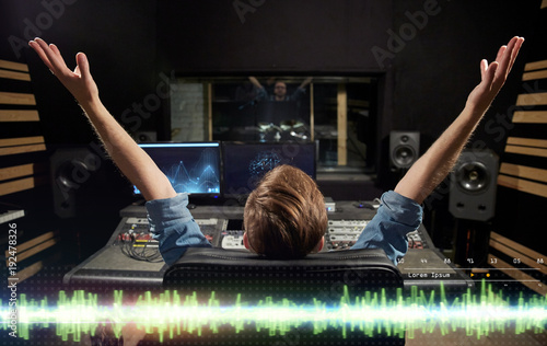 Fotografie, Obraz  man at mixing console in music recording studio