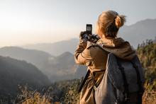 Backpacker  Girl Make Photo By Phone