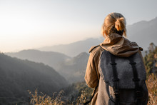 Backpacker Girl In The Mountains