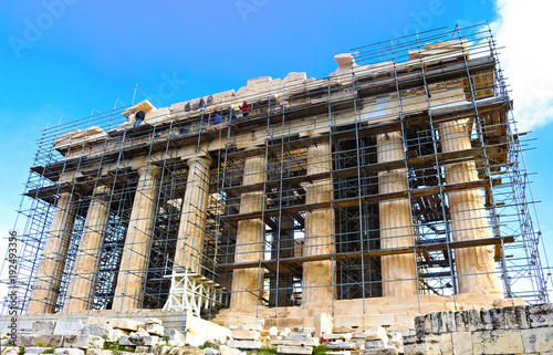Staande foto Oude gebouw Workers up high on scaffoling for restoration work on the ancient Parthenon on the Accropolis in Athens Greece 1 - 3 - 2018