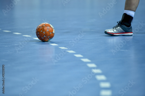 Handball ball lie on the 9 meters line on the pitch