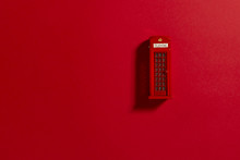Red Phone Box On A Red Backgro...