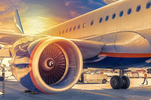 Fényképezés  Plane close up engine with blue sky and clouds